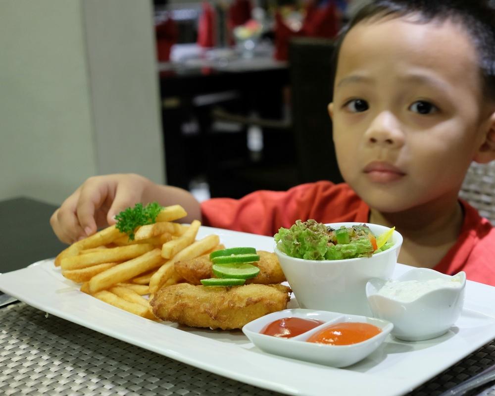 Enjoying his Fish & Chips